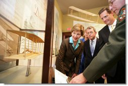 Mrs. Laura Bush, U.S.Senator. Mike DeWine, and U.S.Rep. Mike Turner listen to National Park Ranger Larry Blake as he shows them a model of the Wright Brothers airplane during a tour of the Dayton Aviation Heritage National Historical Park in the Wright-Dunbar Village, a Preserve America neighborhood, in Dayton, Ohio, Wednesday, August 16, 2006. Also shown is Fran DeWine, wife of Sen. Mike DeWine. White House photo by Shealah Craighead