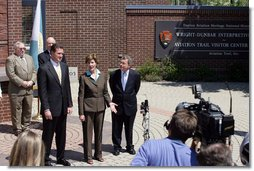 Mrs. Laura Bush joined by, from left, U.S.Rep. Mike Turner and U.S. Sen. Mike DeWine talk to the press after touring Wright-Dunbar Village in Dayton, Ohio, Wednesday, August 16, 2006. The Village is a Preserve America neighborhood that is home to the historic sites where the Wright brothers worked on the inventions that led to flight and Paul Laurence Dunbar printed his newspaper.  White House photo by Shealah Craighead