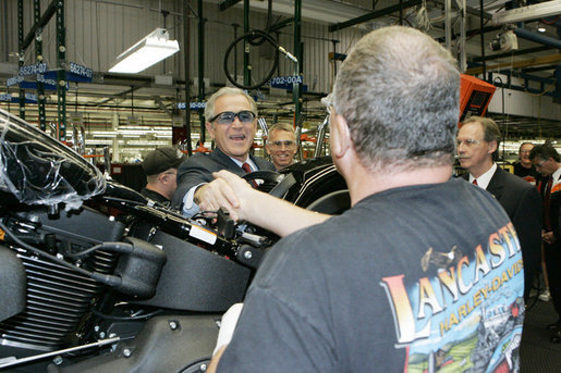 President George W. Bush meets workers along the assembly line during a tour of the Harley-Davidson Vehicle Operations facility Wednesday, Aug. 16, 2006 in York, Pa., where he participated in a roundtable discussion on the economy. White House photo by Kimberlee Hewitt