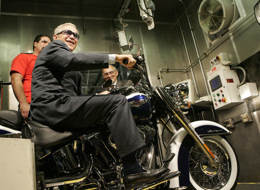 President George W. Bush sits on a motorcycle at the roll test section of the assembly line at the Harley-Davidson Vehicle Operations facility Wednesday, Aug. 16, 2006 in York, Pa., where President Bush also participated in a roundtable discussion on the economy. White House photo by Kimberlee Hewitt