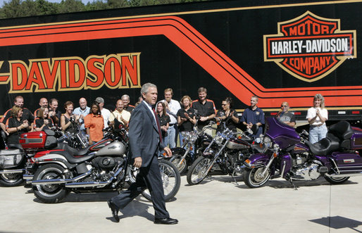 President George W. Bush is applauded as he arrives to deliver his remarks on the economy following his tour of the Harley-Davidson Vehicle Operations facility Wednesday, Aug. 16, 2006, in York, Pa. White House photo by Kimberlee Hewitt