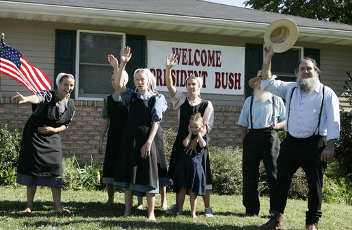 An excited group of Amish and Mennonite residents wave to President George W. Bush Wednesday, Aug. 16, 2006 in Lancaster, Pa., upon his arrival aboard Marine One. White House photo by Kimberlee Hewitt