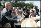 President George W. Bush meets with Amish and Mennonite residents Wednesday, Aug. 16, 2006 in Lancaster, Pa., upon his arrival aboard Marine One. White House photo by Kimberlee Hewitt