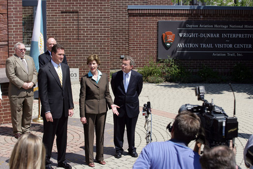 Mrs. Laura Bush joined by, from left, U.S. Rep. Mike Turner and U.S. Sen. Mike DeWine talk to the press after touring Wright-Dunbar Village in Dayton, Ohio, Wednesday, August 16, 2006. The Village is a Preserve America neighborhood that is home to the historic sites where the Wright brothers worked on the inventions that led to flight and Paul Laurence Dunbar printed his newspaper. White House photo by Shealah Craighead