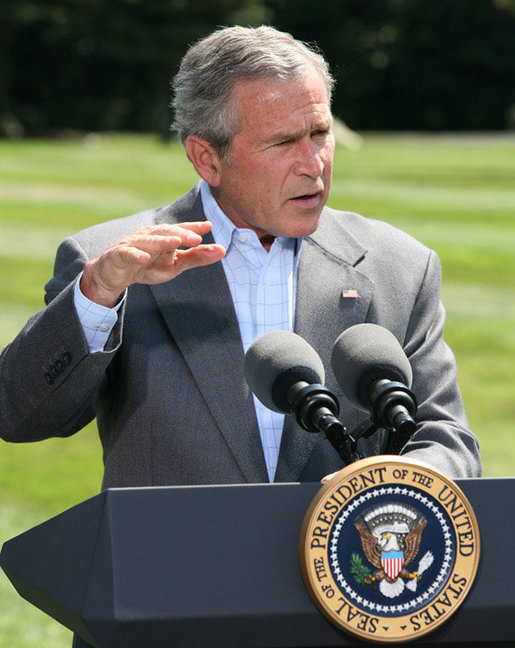 President George W. Bush gestures as he answers a reporter's question Friday, Aug. 18, 2006 in Camp David, Md., following a meeting with his economic advisors. White House photo by Eric Draper
