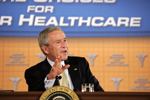 President George W. Bush participates in a panel discussion Tuesday, Aug. 22, 2006, at the Minneapolis Marriott Southwest in Minnetonka, Minn., to offer perspectives on efforts to enhance health care transparency and move towards a value-based health care competition. White House photo by Paul Morse