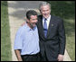 "President George W. Bush smiles as he stands with Rockey Vaccarella during a statement to the media Wednesday, Aug. 23, 2006, on the White House lawn. Vaccarella, who lost his home in the wake of Hurricane Katrina and who drove to Washington D.C. to speak directly to the President, told reporters, ""I just don't want the government and President Bush to forget about us,"" adding, ""If we had this President for another four years, I think we'd be great."" White House photo by Kimberlee Hewitt"