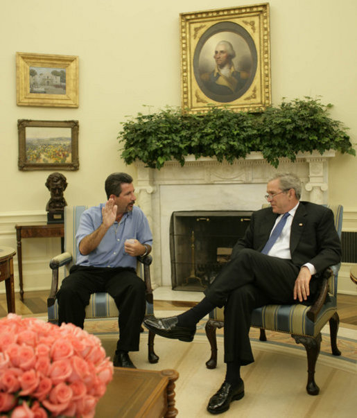 "President George W. Bush shares a moment with Rockey Vaccarella Wednesday, Aug. 23, 2006, in the Oval Office of the White House. The St. Bernard Parish resident who drove from Louisiana to meet with the President said ""I wanted to thank President Bush for the millions of FEMA trailers that were brought down there."" He added, "". I just don't want the government and President Bush to forget about us."" White House photo by Paul Morse"