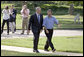 President George W. Bush and Rockey Vaccarella of New Orleans walk to the Oval Office after delivering a joint statement to the press on the South Lawn Wednesday, Aug. 23, 2006. Vaccarella, who lost his home in the wake of Hurricane Katrina, drove to Washington, D.C., with the hopes of speaking directly with President Bush. White House photo by Paul Morse