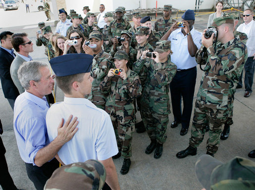President George W. Bush meets military personnel upon his arrival Monday, Aug. 28, 2006, to Kessler Air Force Base in Biloxi, Miss., his first stop during a two-day visit to Biloxi and New Orleans to commemorate the one-year anniversary of Hurricane Katrina. White House photo by Eric Draper