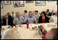 President George W. Bush is joined by Mississippi Governor Haley Barbour, left, as they attend a working luncheon with Mississippi community and housing officials at the Biloxi Schooner Restaurant to discuss the state's recovery and rebuilding efforts Monday, Aug. 28, 2006 in Biloxi, Miss., on the one-year anniversary of Hurricane Katrina. White House photo by Eric Draper