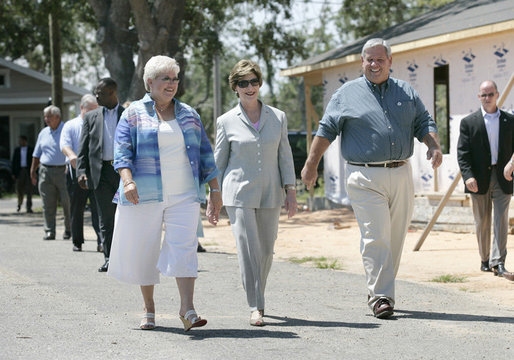 "Mrs. Laura Bush meets with Biloxi, Miss., residents Sandy Patterson, left, and her husband, Thomas ""Lynn"" Patterson Monday, Aug. 28, 2006, during a walking tour in the same Biloxi neighborhood President George W. Bush visited following Hurricane Katrina in September 2005. The tour allowed President Bush the opportunity to assess the progress of the area's recovery and rebuilding efforts a year after the devastating hurricane. White House photo by Eric Draper"