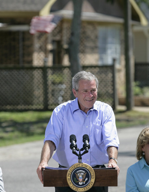 President George W. Bush smiles as he addresses his remarks to residents and state community leaders Monday, Aug. 28, 2006, following his walking tour through the Biloxi, Miss., neighborhood he visited following Hurricane Katrina in September 2005. The tour allowed President Bush the opportunity to assess the progress of the area's recovery and rebuilding efforts a year after the devastating hurricane. White House photo by Eric Draper