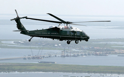 U.S. Marine One carrying President George W. Bush flies above a bridge construction project Monday, Aug. 28, 2006, on a flight from Mississippi to Louisiana, where President Bush is on a two-day visit to the Gulf Region to assess the region's recovery and rebuilding efforts a year after the devastation of Hurricane Katrina. White House photo by Eric Draper