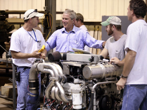 President George W. Bush visits workers at the United States Marine, Inc. boat manufacturing facility in Gulfport, Miss., Monday, Aug. 28, 2006, as part of the President's two-day tour of the Gulf Coast region to assess the progress of the area's recovery and rebuilding efforts following the devastation of Hurricane Katrina in 2005. White House photo by Eric Draper