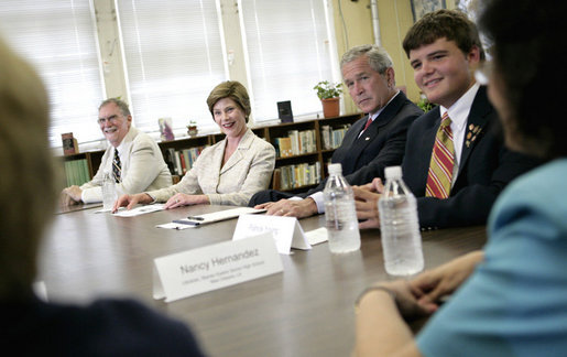 President George W. Bush and Laura Bush participate at a roundtable discussion Tuesday, Aug. 29, 2006, at Warren Easton Senior High School in New Orleans on the importance of rebuilding schools and school libraries, as the Gulf Coast marked the one- year anniversary of Hurricane Katrina. Mrs. Bush, speaking about the Laura Bush Foundation for America's Libraries Gulf Coast School Library Recovery Initiative, congratulated the ten schools represented at the table on being awarded the first-round grants to help rebuild their schools. White House photo by Eric Draper