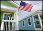 President George W. Bush stands with Fredy Omar outside his newly built home Tuesday, Aug. 29, 2006, in the Musicians' Village, where the President and Mrs. Bush hosted an outdoor luncheon for approximately 50 Habitat for Humanity volunteers in appreciation of their work at the 9th Ward home site. White House photo by Eric Draper