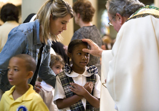 A young girl receives a blessing during a memorial Mass attended by President George W. Bush and Laura Bush at St. Louis Cathedral in New Orleans, Tuesday morning, Aug. 29, 2006, to commemorate the one- year anniversary of Hurricane Katrina. White House photo by Eric Draper
