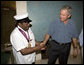 President George W. Bush shakes the hand of legendary Fats Domino, wearing a National Medal of Arts, after the President presented it Tuesday, Aug. 29, 2006, at the musician's home in the Lower 9th Ward of New Orleans. The medal was a replacement medal for the one -- originally awarded by President Bill Clinton -- that was lost in the flood waters of Hurricane Katrina. White House photo by Eric Draper
