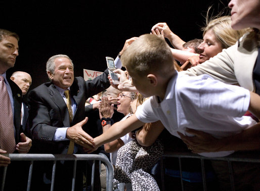"President George W. Bush greets the crowd during an airport welcome at the Utah Air National Guard in Salt Lake City, Utah, Wednesday, Aug. 30, 2006. Nearly 2000 local residents and base personnel turned out to welcome the President. ""For those of you with loved ones in the United States military, I thank you from the bottom of my heart, said President Bush in his remarks. ""I can't tell you how proud I am to be the Commander-in-Chief of such a fantastic group of young men and women."" White House photo by Eric Draper"