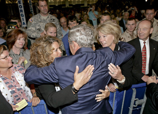 President George W. Bush greets audience members during his visit to the 88th Annual American Legion National Convention in Salt Lake City Thursday, Aug. 31, 2006. White House photo by Eric Draper