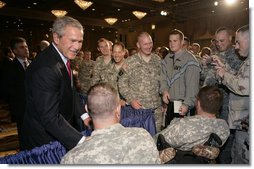 "President George W. Bush is greeted by military personnel following his address on the global war on terror at the Military Officers Association of America meeting Tuesday, Sept. 5, 2006, at the Capital Hilton Hotel in Washington. President Bush spoke about the U.S. and allies strategy for combating terrorism saying ""we're confronting them before they gain the capacity to inflict unspeakable damage on the world, and we're confronting their hateful ideology before it fully takes root."" White House photo by Kimberlee Hewitt"
