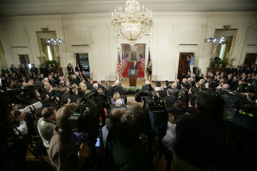 "President George W. Bush addresses invited guests, members of the media and White House staff Wednesday. Sept. 6, 2006 in the East Room of the White House, as he discusses the administration's draft legislation to create a strong and effective military commission to try suspected terrorists. The bill being sent to Congress said President Bush, ""reflects the reality that we are a nation at war, and that it is essential for us to use all reliable evidence to bring these people to justice."" White House photo by Kimberlee Hewitt"