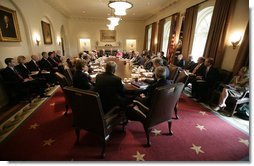 President George W. Bush meets with members of his Cabinet and staff Wednesday, Sept. 6, 2006, in the Cabinet Room at the White House, prior to the President's address to discuss the creation of military commissions to try suspected terrorists.  White House photo by Eric Draper
