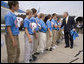 President George W. Bush congratulates members of the Columbus Northern Little League Team on winning the 2006 Little League Baseball World Series Championship at Dobbins Air Reserve Base in Marietta, Ga., Thursday, Sept. 7, 2006. White House photo by Eric Draper