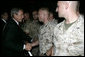 President George W. Bush shakes hands with U.S. Marine reservists from the 4th Civil Affairs Group based in Anacostia, Washington, who are deploying to the Al Anbar Province in Iraq, at Andrews Air Force Base, Friday, September 8, 2006. White House photo by Kimberlee Hewitt