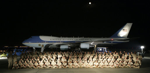 In front of Air Force One at Andrews Air Force Base, President George W. Bush greets U.S. Marine reservists from the 4th Civil Affairs Group based in Anacostia, Washington, who are deploying to the Al Anbar Province in Iraq, Friday, September 8, 2006. White House photo by Kimberlee Hewitt