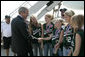 President George W. Bush is greeted Friday, Sept. 8, 2006, by members of the Mattawan Little League team from Mattawan, Mich., at Bishop International Airport in Flint, Mich. The team won all 23 games it played this summer and went on to take the 2006 Little League Softball World Series Championship. White House photo by Kimberlee Hewitt