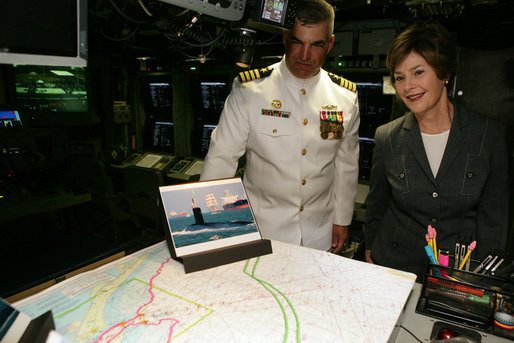 Mrs. Laura Bush and Captain John Litherland, Commanding Officer of the USS Texas, pause in the control room of the submarine during a tour of the ship Saturday, September 9, 2006, in Galveston, Texas. Mrs. Bush later participated in the Commissioning Ceremony marking the entry of the vessel into the U.S. Atlantic Fleet. White House photo by Shealah Craighead