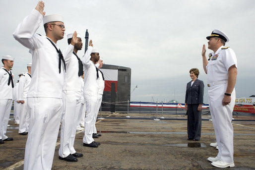 Mrs. Laura Bush observes a U.S. Navy Re-enlistment Ceremony Saturday, September 9, 2006, as Rear Admiral Fox, Director, White House Military Office, administers the oath to sailors prior to the Commissioning Ceremony of the USS Texas in Galveston, Texas. White House photo by Shealah Craighead