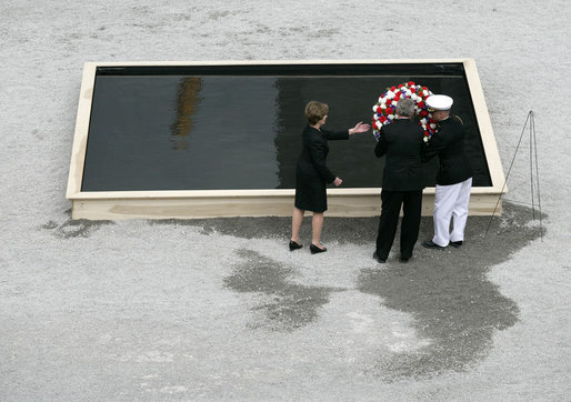 To commemorate the fifth anniversary of the terrorist attacks on September 11, 2001, President George W. Bush and Laura Bush lay a wreath in the south tower reflecting pool at the World Trade Center site in New York City Sunday, September 10, 2006. White House photo by Eric Draper