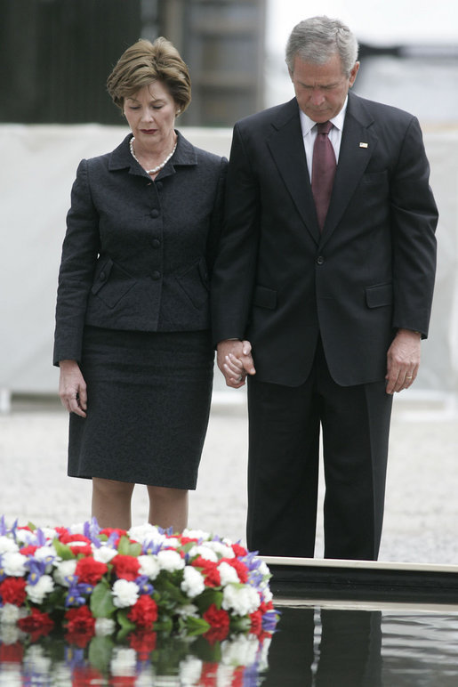 President George W. Bush and Laura Bush stand in silence after laying a wreath in the north reflecting pool at Ground Zero September 10, 2006, in commemoration of the fifth anniversary of the terrorist attacks of September 11, 2001, on the World Trade Center in New York City. White House photo by Kimberlee Hewitt