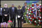 President George W. Bush and Laura Bush stand in silence after placing a wreath to commemorate the fifth anniversary of the September 11th attacks Monday, Sept. 11, 2006, in Shanksvillle, Pa., where United flight 93 crashed after the passengers fought against the terrorist hijackers. White House photo by Eric Draper