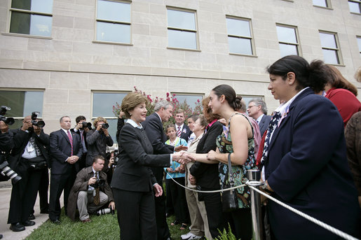 After placing a memorial wreath at the Pentagon, the President and Laura Bush greet audience members Monday, Sept. 11, 2006, during ceremonies marking the fifth anniversary of the September 11th attacks. White House photo by Eric Draper