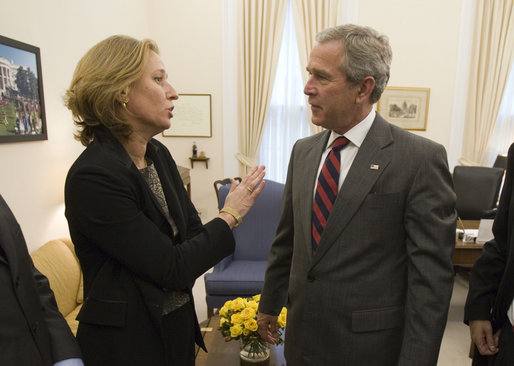 President George W. Bush drops by a meeting between National Security Advisor Stephen Hadley and Minister of Foreign Affairs Tzipi Livni of Israel at the White House Wednesday, Sept. 13, 2006. White House photo by Eric Draper