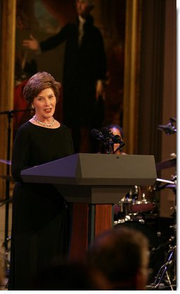 Mrs. Laura Bush welcomes guests to the East Room for entertainment Thursday night, Sept. 14, 2006, during the Thelonious Monk Institute of Jazz dinner at the White House. White House photo by Shealah Craighead