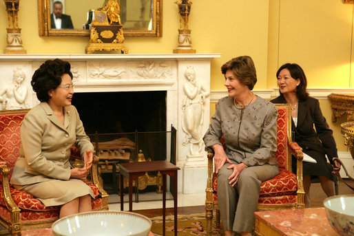 Mrs. Laura Bush talks with Mrs. Kwon Yang-Sook, wife of the President of South Korea, Thursday, September 14, 2006, during a coffee hosted by Mrs. Bush at the White House. White House photo by Shealah Craighead