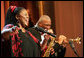 "Jazz vocalist Lisa Henry and saxophonist Bobby Watson perform their version of ""Kansas City"" during the Thelonious Monk Institute of Jazz dinner Thursday night, Sept. 14, 2006, in the East Room of the White House. White House photo by Shealah Craighead"