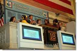Mrs. Laura Bush is applauded as she stands over the New York Stock Exchange Monday, Sept. 18, 2006, where she visited to highlight literacy's role in extending the benefits of free enterprise to individuals around the world.  White House photo by Shealah Craighead