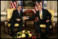 President George W. Bush exchanges handshakes with El Salvador's President Elias Antonio Saca at the start of their bilateral meeting Monday, Sept. 18, 2006, at New York's Waldorf-Astoria Hotel. White House photo by Eric Draper