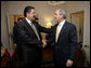 President George W. Bush and President Manuel Zelaya of Honduras greet each other before meeting, Monday, Sept. 18, 2006, at the Waldorf-Astoria Hotel in New York. White House photo by Eric Draper