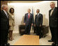 President George W. Bush stands with Kofi Annan, Secretary-General of the United Nations, after the President's arrival Tuesday, Sept. 19, 2006, to the U.N. in New York. With them are from left: Josh Bolten, White House Chief of Staff; Condoleezza Rice, Secretary of State, and Mark Malloch Brown, Deputy Secretary-General of the U.N. White House photo by Eric Draper
