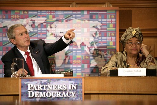 President George W. Bush sits next to Liberia's President Ellen Johnson-Sirleaf during a roundtable discussion on democracy Tuesday, Sept. 19, 2006, during the President's visit to New York City for the 61st United Nations General Assembly. White House photo by Eric Draper