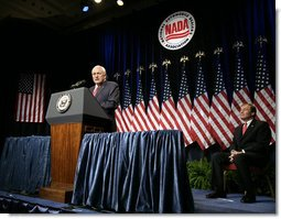 Vice President Dick Cheney delivers remarks on the economy and the global war on terror, Tuesday, September 19, 2006, at the National Automobile Dealers Association 2006 Legislative Conference in Washington, D.C. Seated on stage is Phil Brady, President of the National Automobile Dealers Association.  White House photo by Kimberlee Hewitt