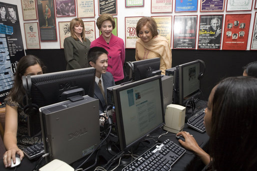 "Mrs. Laura Bush and Mrs. Sehba Musharraf, wife of Pakistan's President Pervez Musharraf, right, watch a demonstration of the new cultural and arts website Thursday, Sept. 21, 2006, with students of Eleanor Roosevelt High School and teacher Elizabeth Putnam, far left, at The John F. Kennedy Center for the Performing Arts in Washington, D.C. The website is created by the Pakistan National Council the Arts and The Kennedy Center and is called, ""Gift of the Indus: The Arts and Culture of Pakistan."" White House photo by Shealah Craighead"