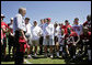 President George W. Bush talks with members of the Tampa Bay Buccaneers during his visit to the NFL team's training facility in Tampa, Fla., Thursday, Sept. 21, 2006. White House photo by Paul Morse